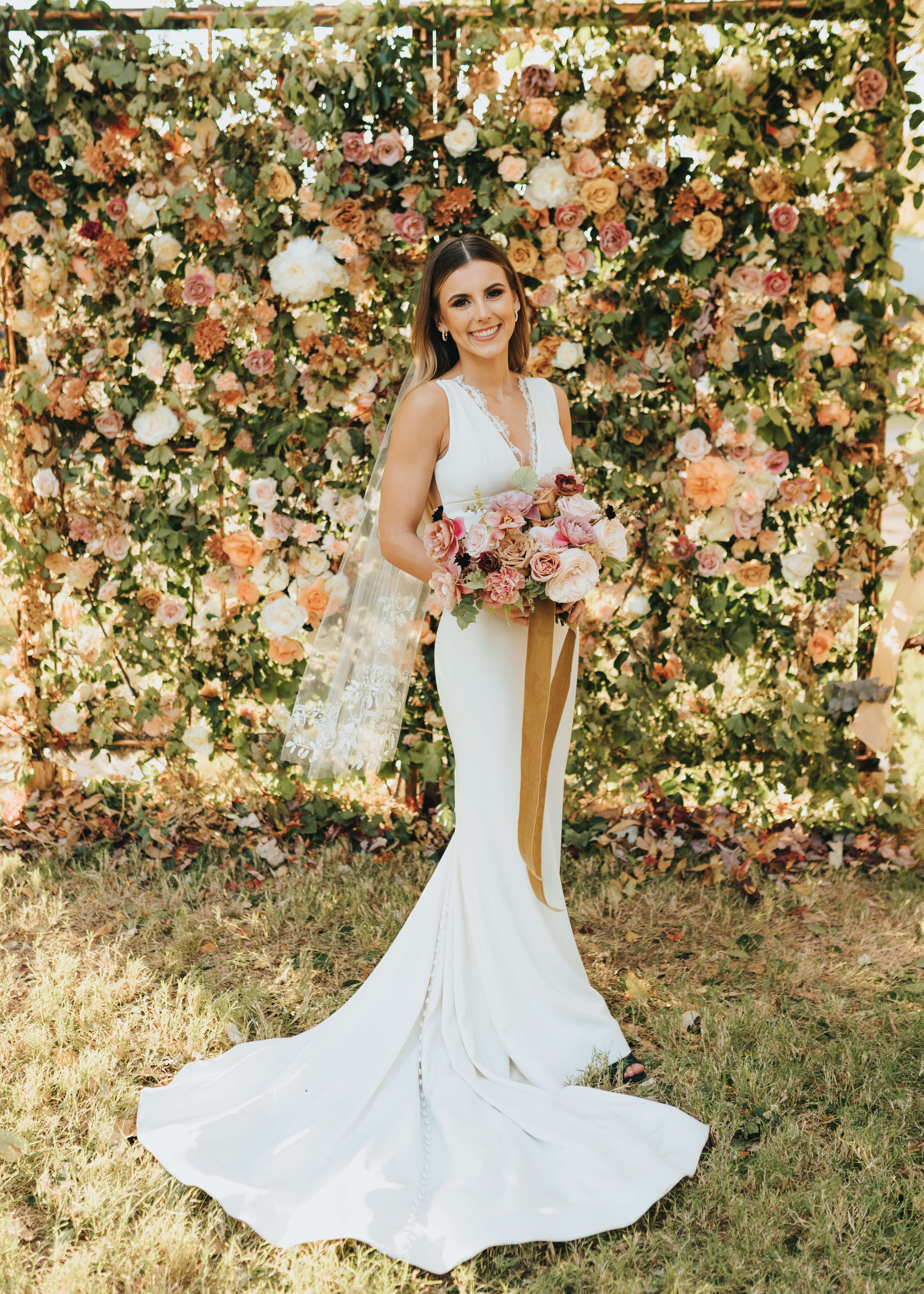 bridal photos by floral wall