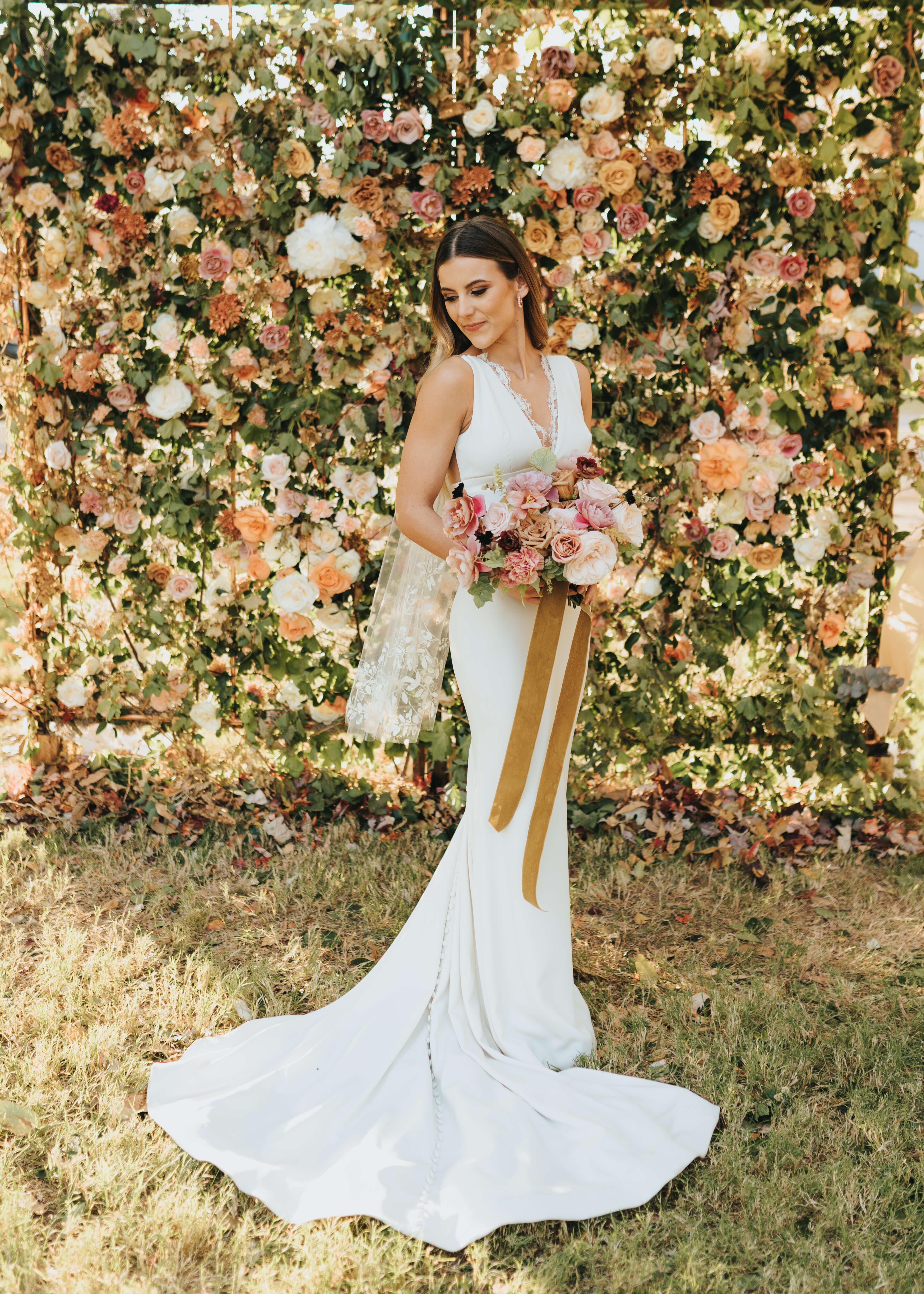 elegant wedding floral wall with bridal photos