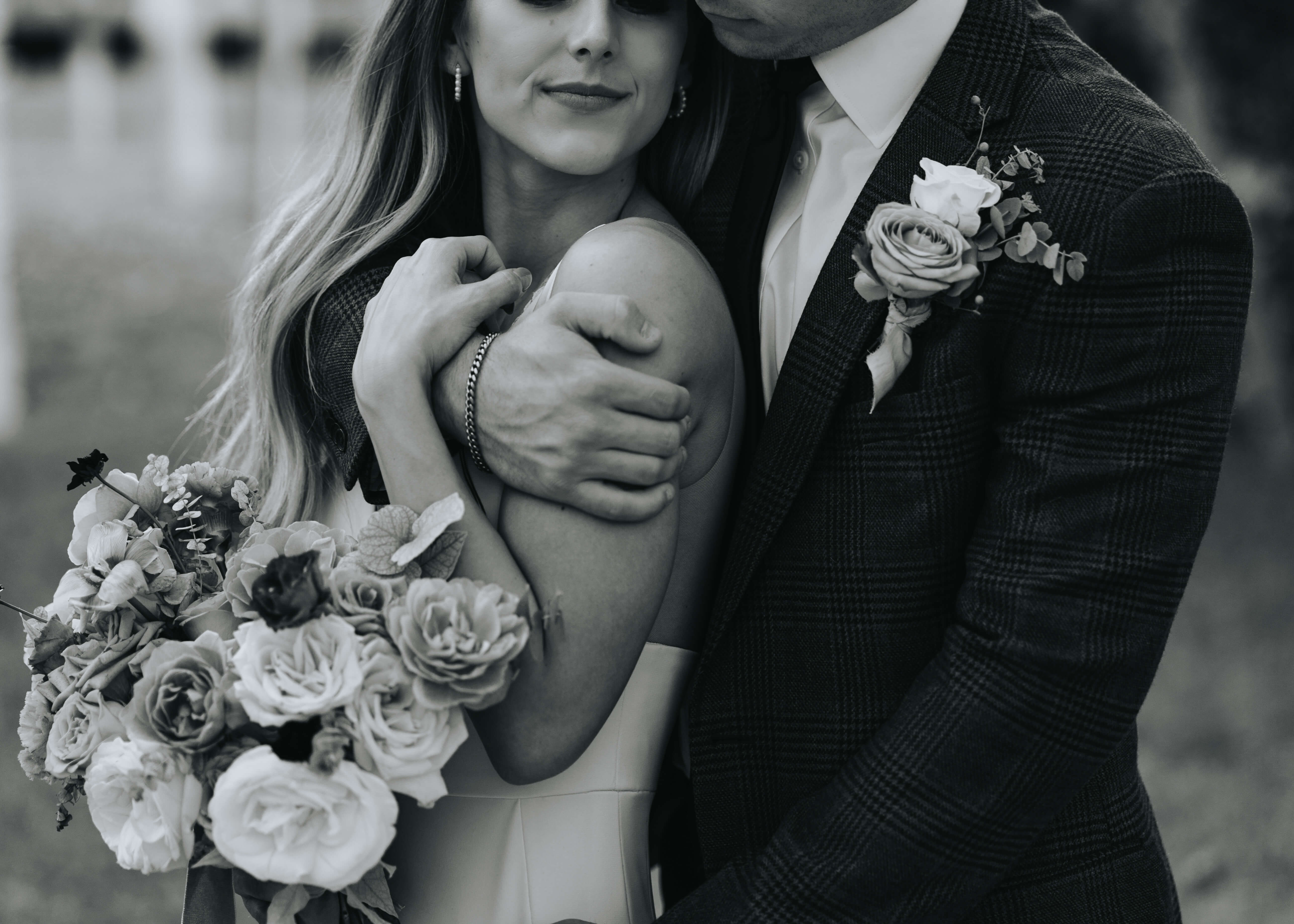 snuggled black and white detail shot of bride and groom