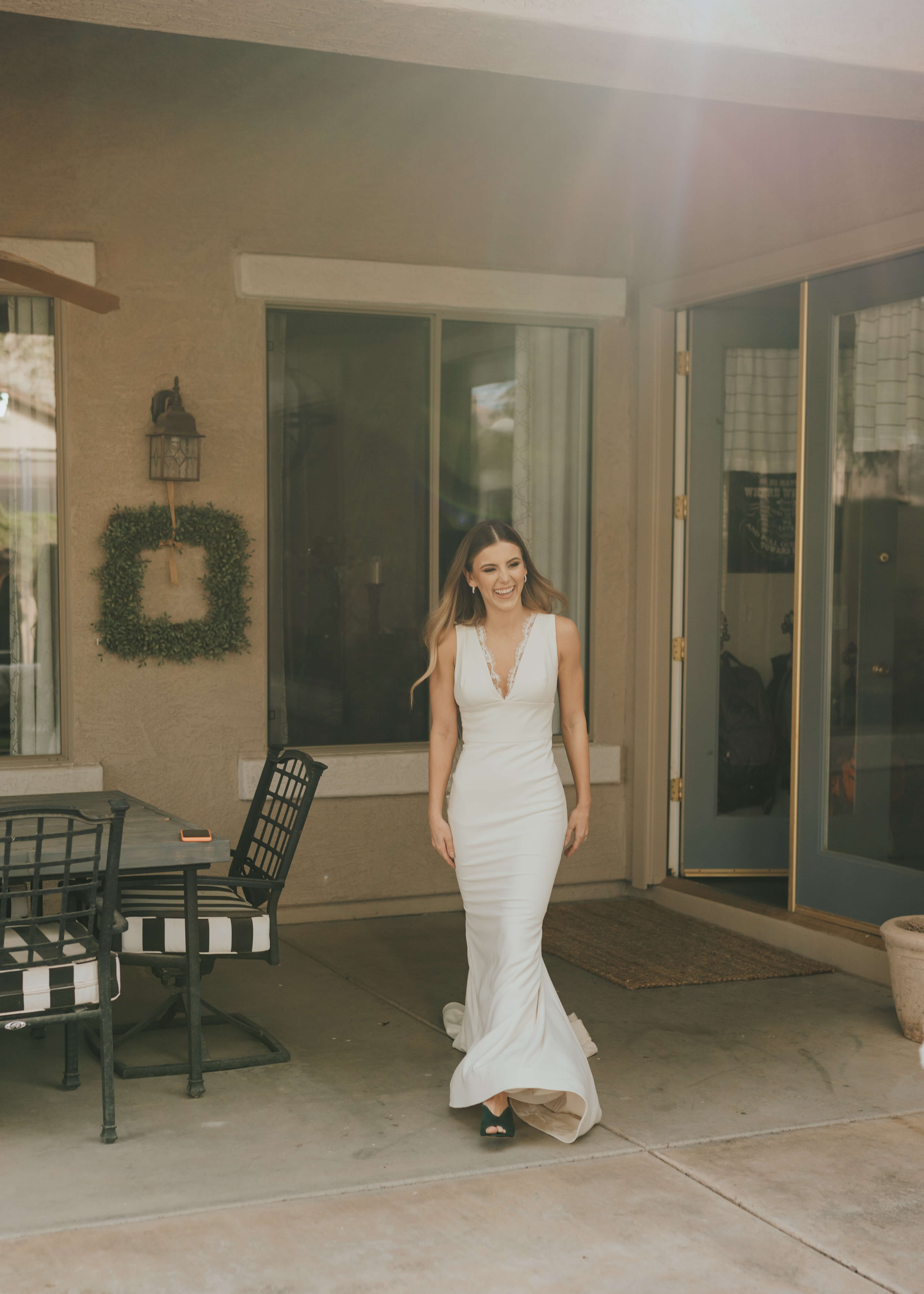 bride walking out to see her bridesmaids for first time