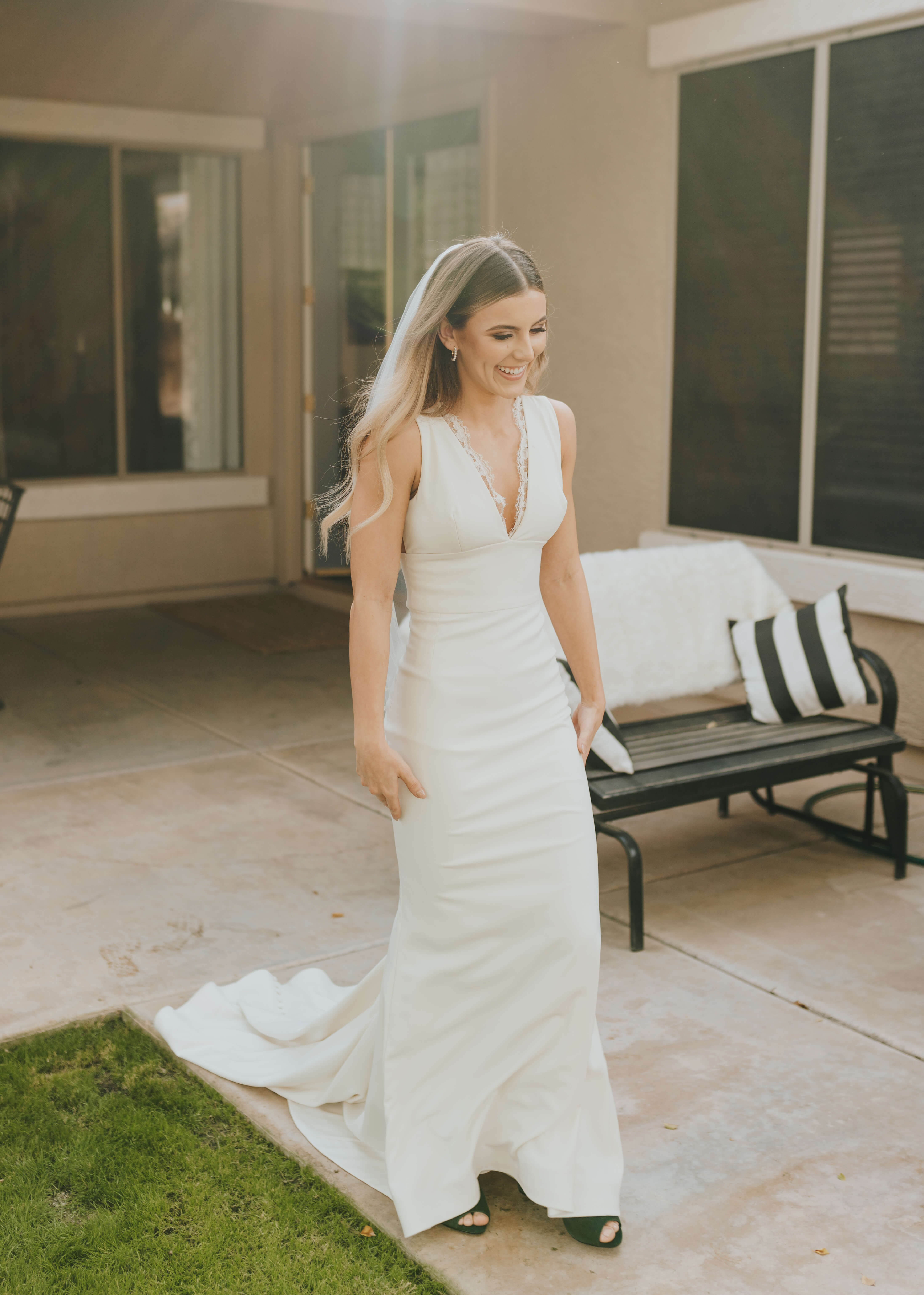 smiling photo of bride meeting her bridesmaids