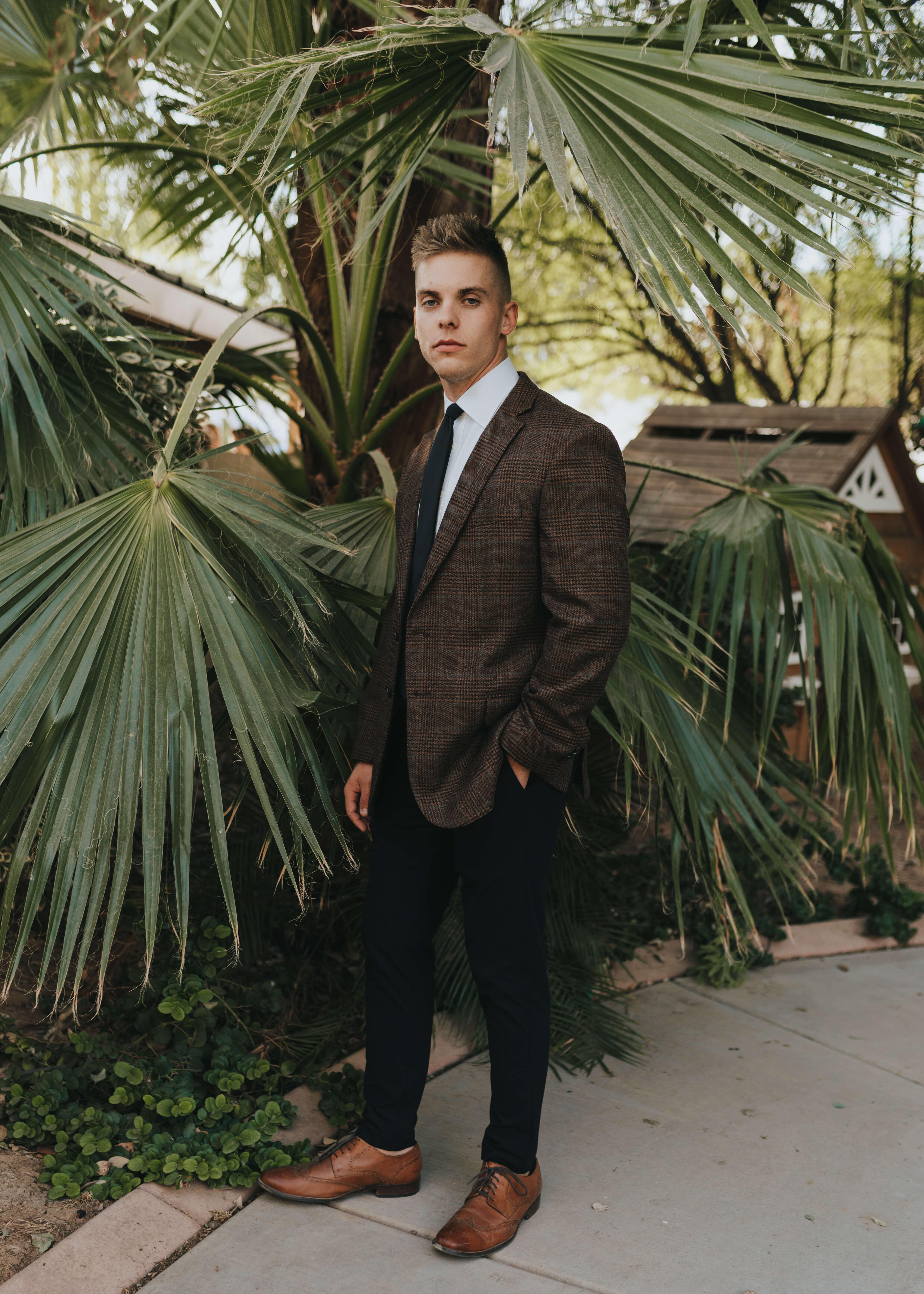brown tweed suit groom with black tie