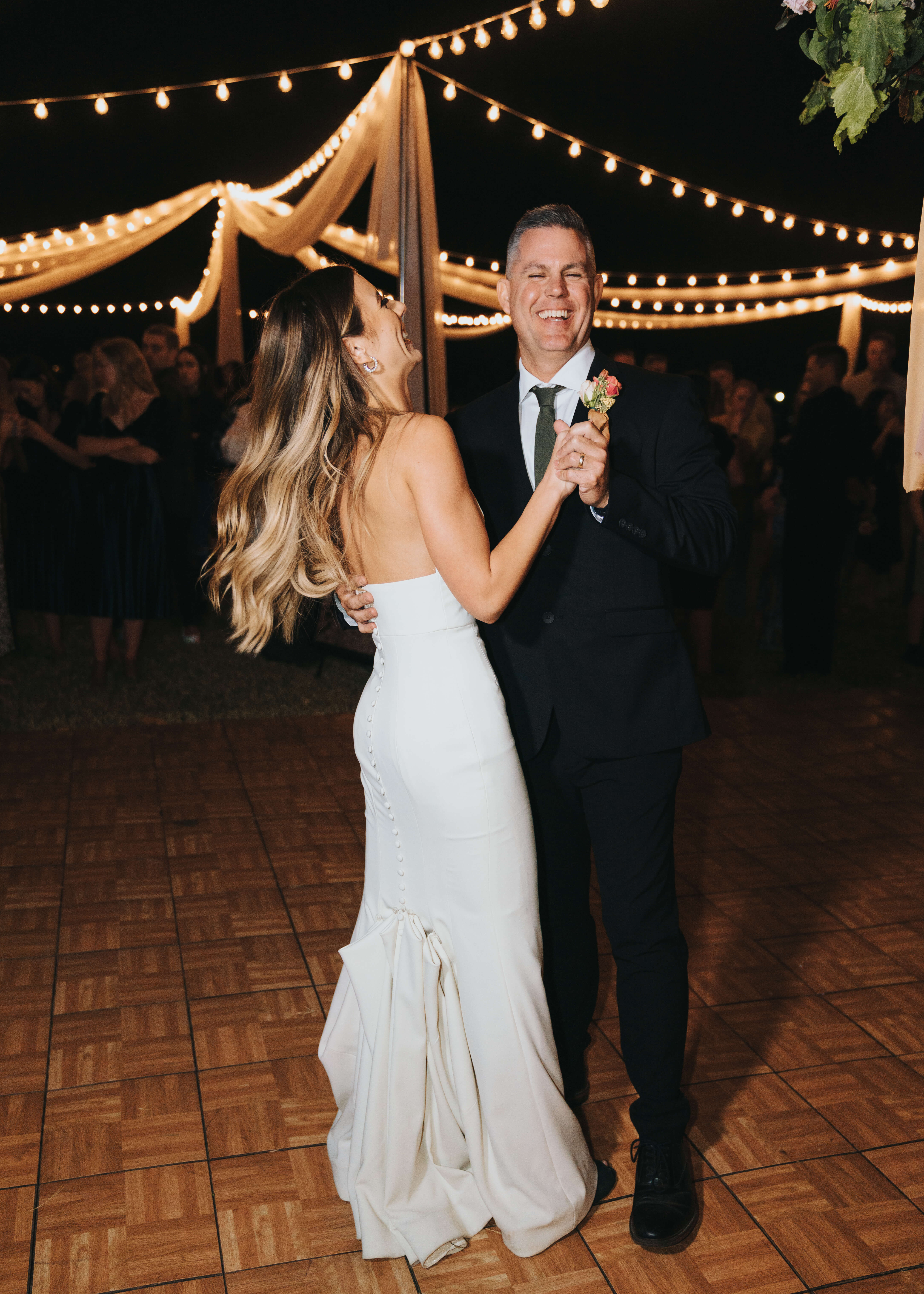 laughing daddy daughter first dance wedding photo
