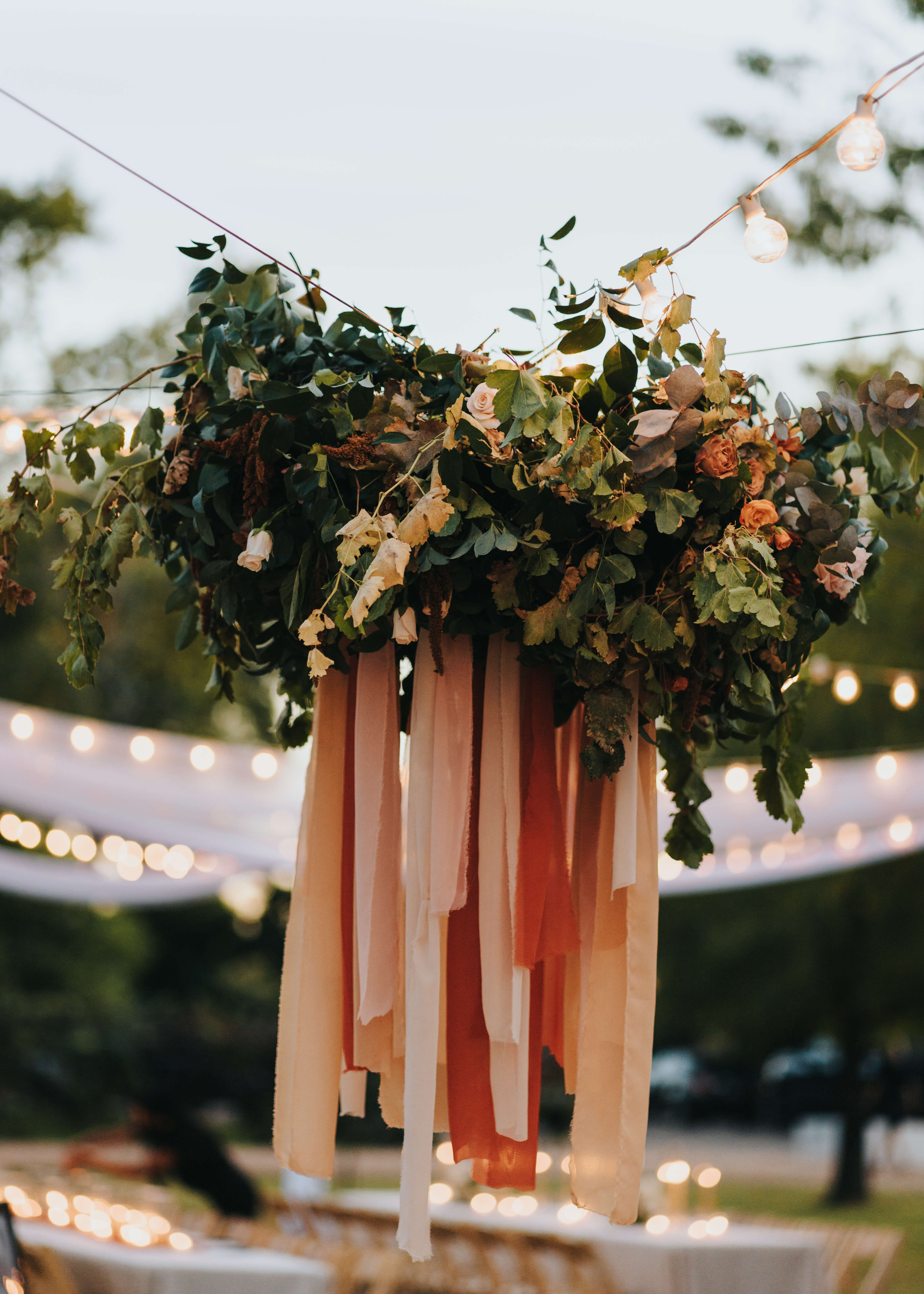 wedding day chandelier with pink flowers and greenery