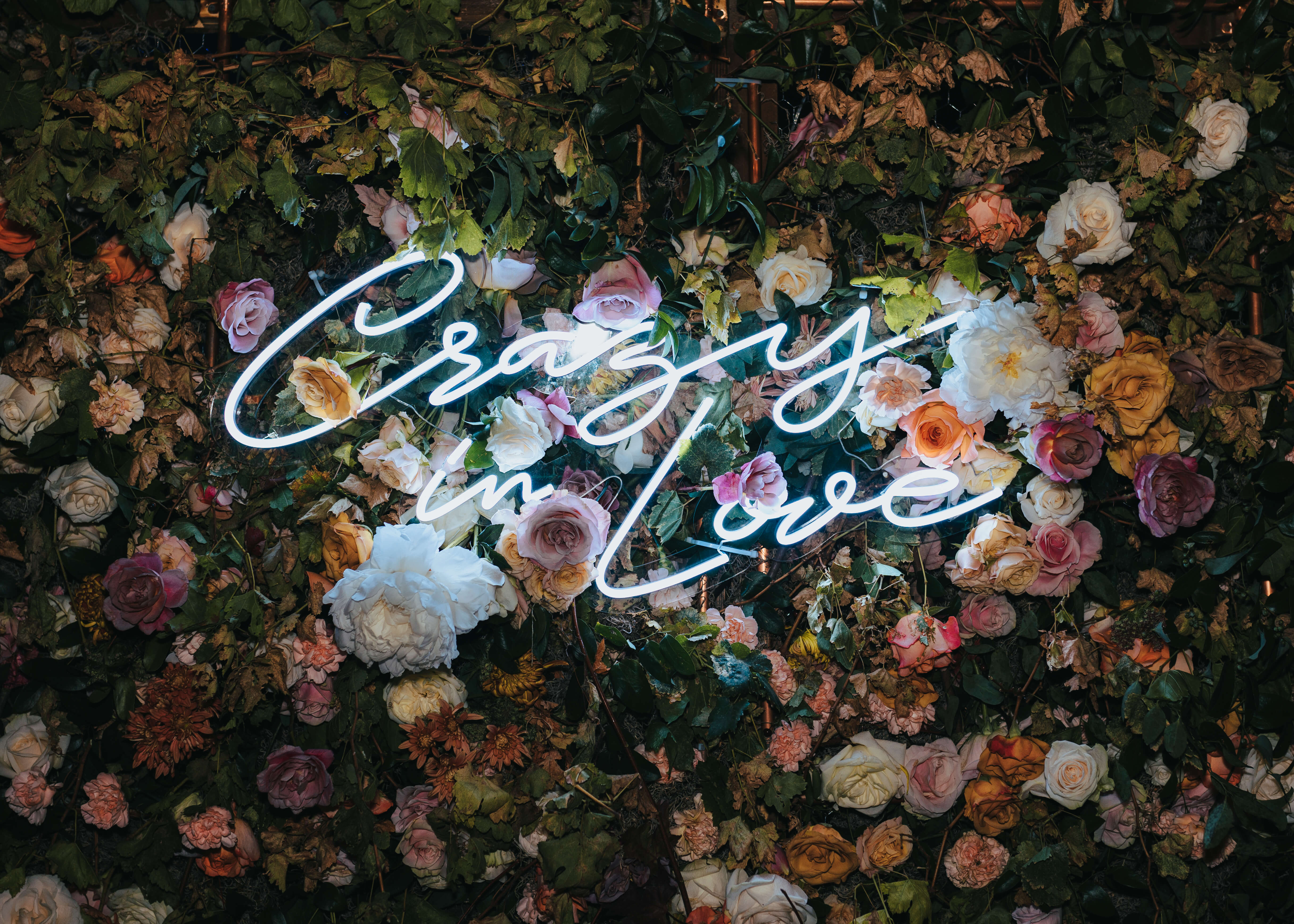 neon wedding sign on floral wall idea photo