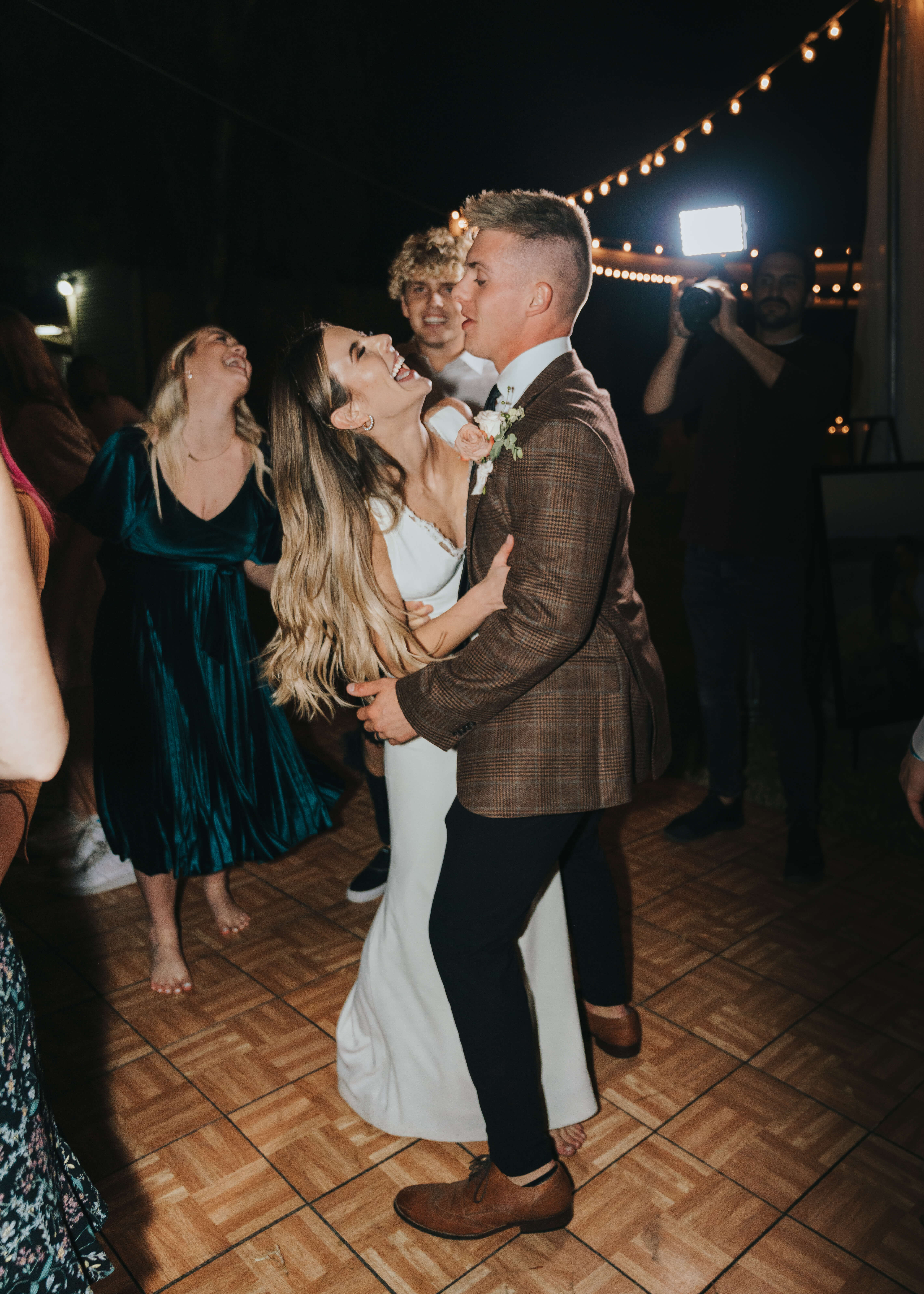 candid dancing photo of bride and groom on wedding day happy and romantic