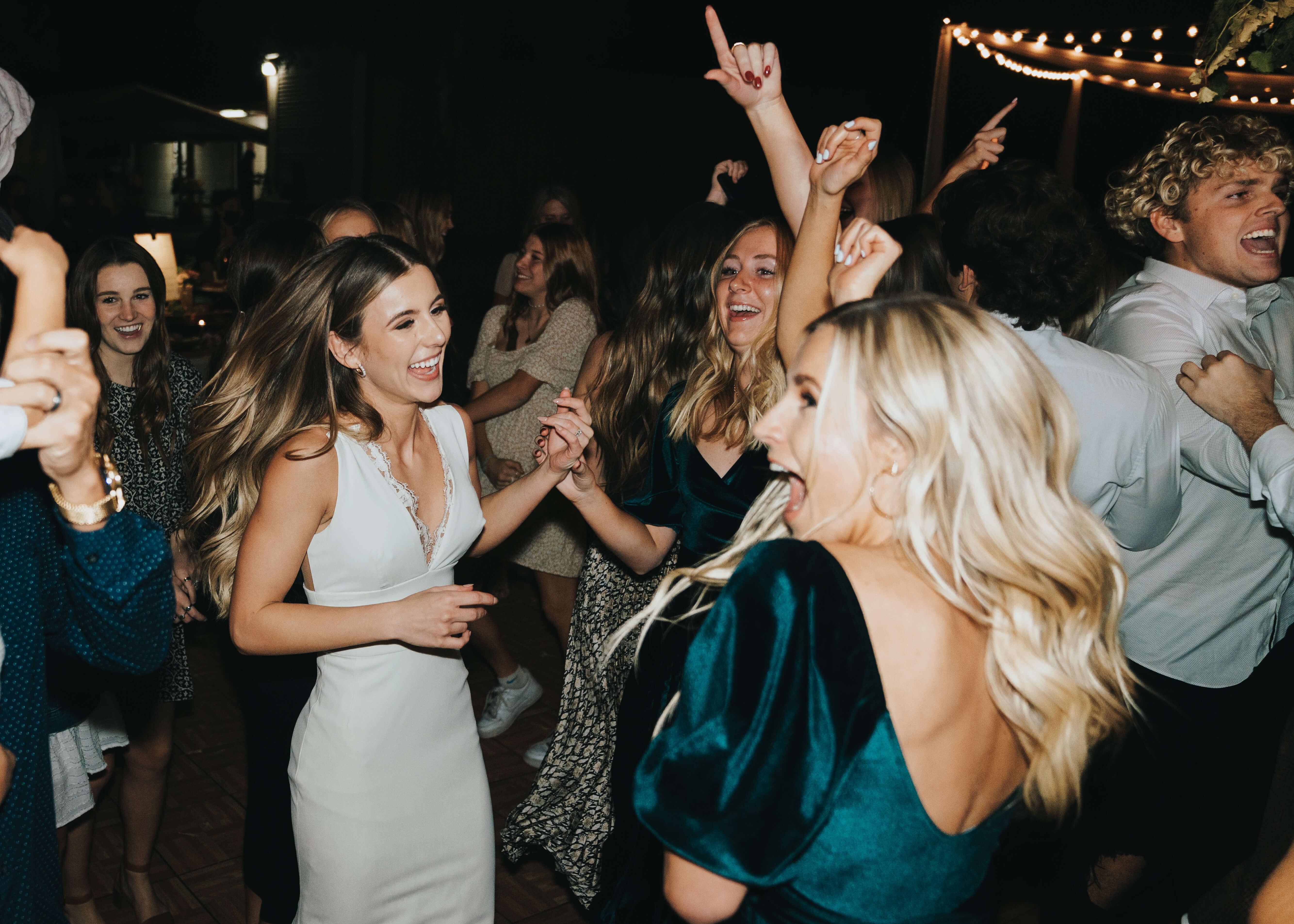 happy dancing photo of bride flash photograpy