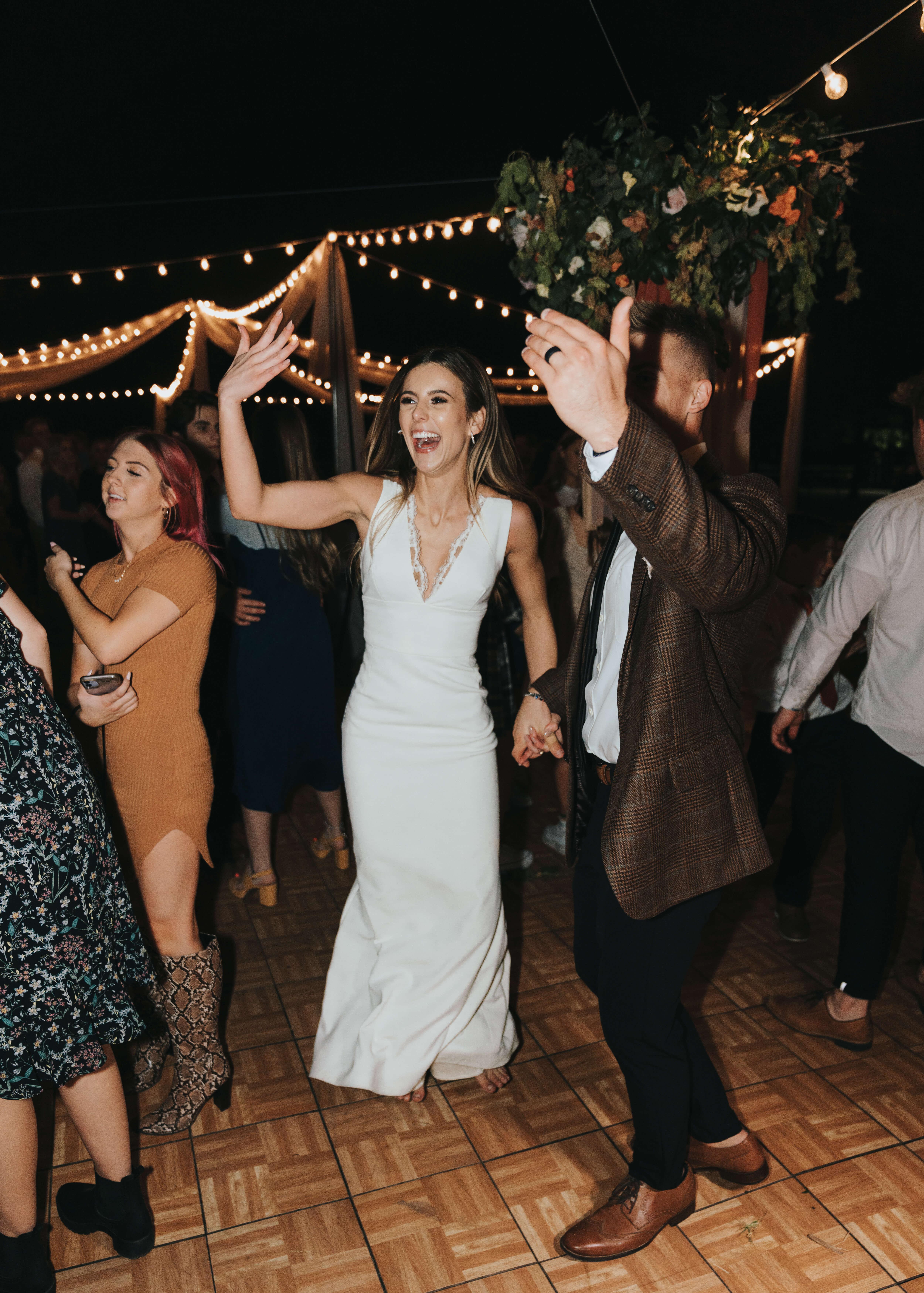 brida and groom dancing together on wedding day