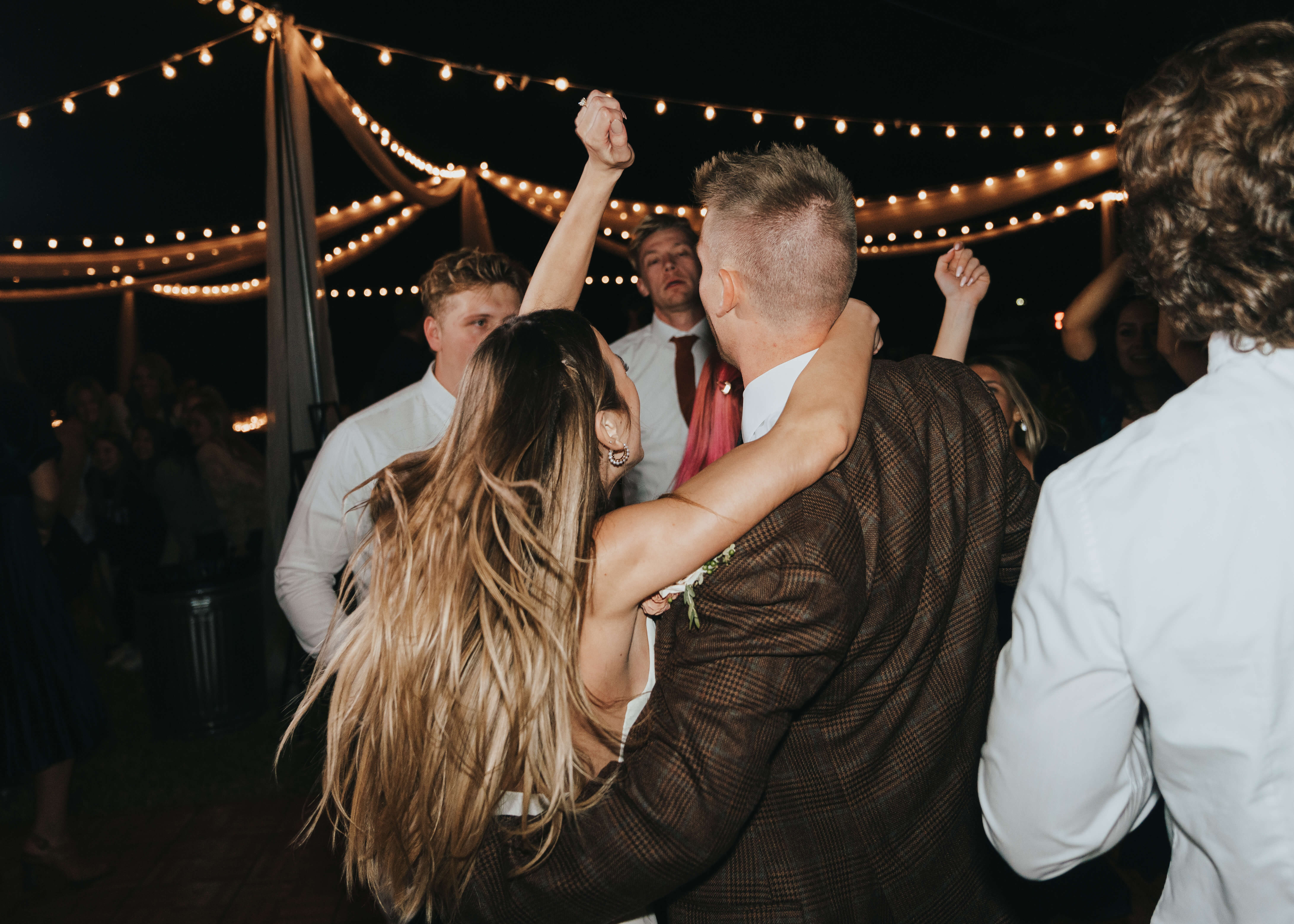 cute candid dancing photo of bride and groom with flash photography
