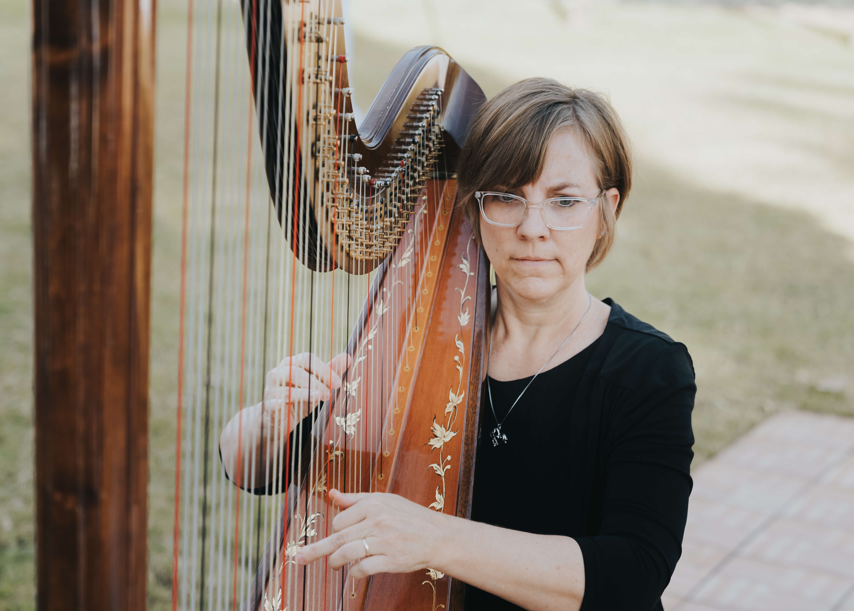 harpist playing at wedding photo