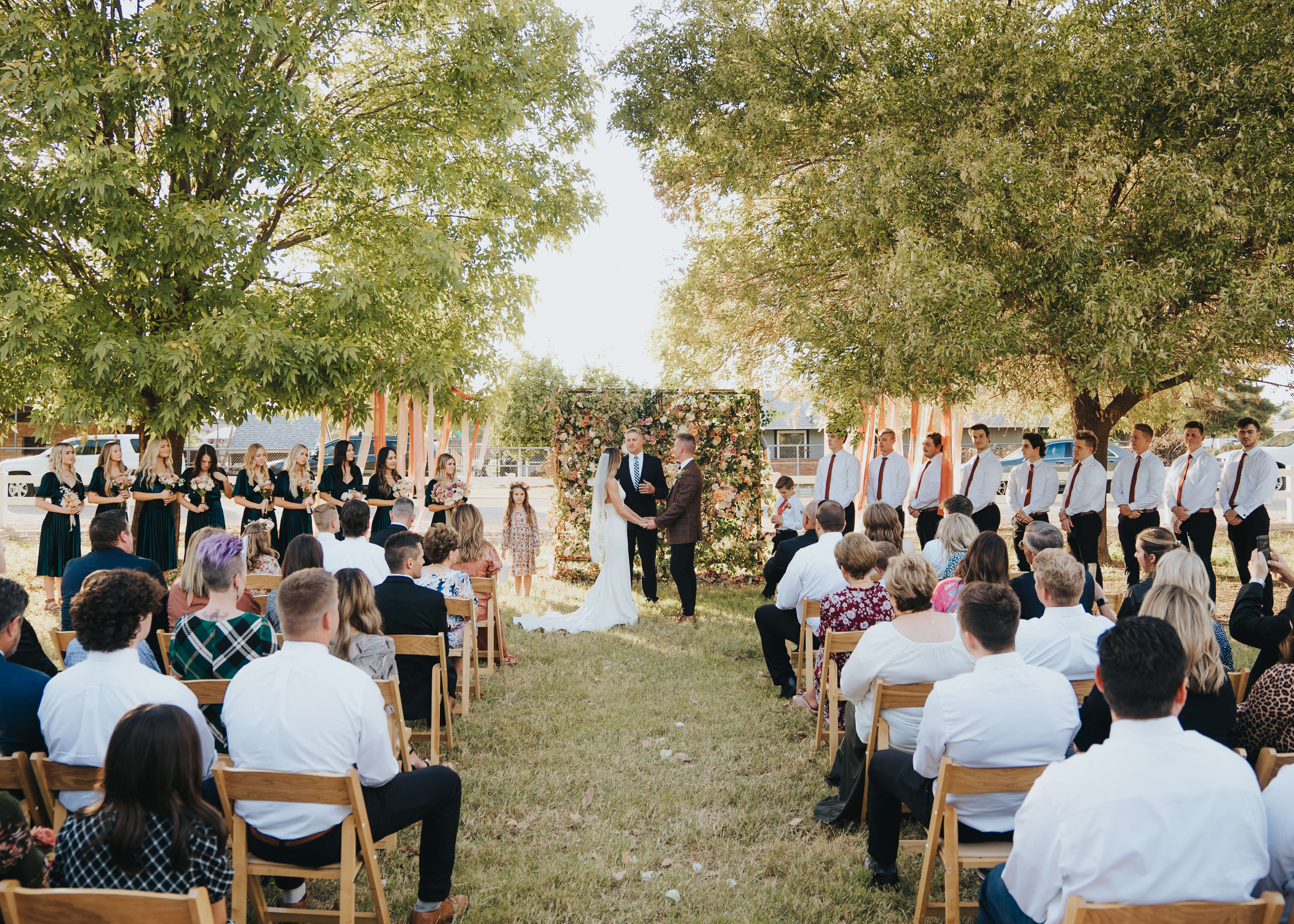 wedding ceremony with floral wall backdrop in arizona